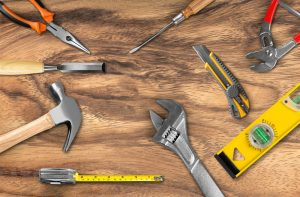 Work,Tools,On,Wooden,Background.